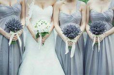 Lavender grey bridesmaids dresses carrying lavender bouquets. Samm Blake via Emmaline Bride