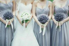 Lavender grey bridesmaids dresses carrying lavender bouquets. Samm Blake via Emmaline Bride