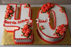 "Roses 40 #83Milestones  This number ""40"" cake is iced in buttercream and trimmed with a red border. Each number is decorated with beautiful two-colored roses."