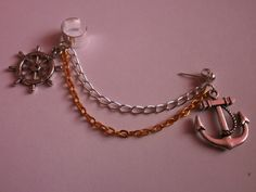 Anchor Charm With Gold & Silver. $5.50, via Etsy. Can switch the cuff for an earring.