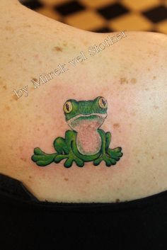 frog tattoo....sitting on a lily pad out of the cancer ribbon?