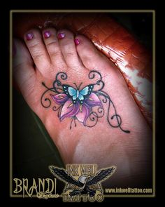 How much does a foot tattoo hurt? We have foot tattoo ideas, designs, pain placement, and we have costs and prices of the tattoo. Calla Lily Tattoos, Flower Tattoos, Ankle Tattoos, Foot Tattoos, New Tattoos, Body Art Tattoos, Tatoos, Butterfly Foot Tattoo, Butterfly Tattoo Designs