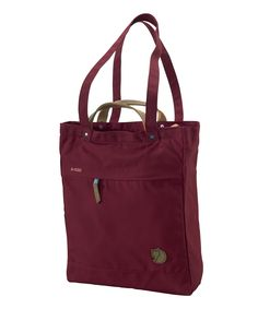 Fjallraven Tote Pack No. 1 in Garnet. Converts from tote to backpack; waxed G-1000 exterior.