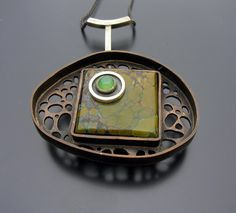 The Mossy Pebbled Path Pendant in Copper and Sterling with Turquoise and Chrysoprase by ashleyjewelry, via Etsy.