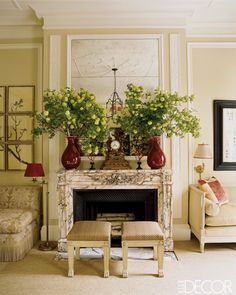 Alessandra Branca keeps it traditionalin this lovely living room. Notice the way shemanages the monumental scale of the room: accenting it witha tall mirror, bringing it down to residential scale with the large vases and floral arrangements, and arriving at human scale with thecozy seating surrounding thefireplace.