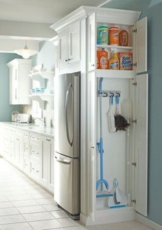 Add a slender cabinet to any dead space in your kitchen. It's a brilliant spot to stash skinny cleaning supplies like brooms and dustpans.