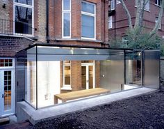 For a lower level (aka basement) a modern conservatory, more of a glass room than a conservatory.