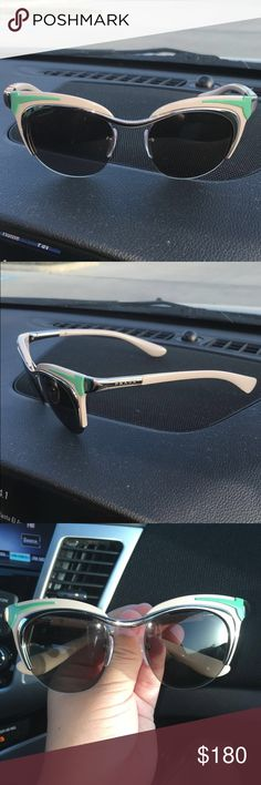 Prada Sunglasses 100% authentic. Never worn. Brand new. Tan color with hint of mint green. Does not come with prada case. Prada Accessories Sunglasses