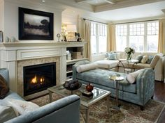 Make the fireplace a dramatic feature, whether your style is contemporary, classic or full-on glam. Take a look through Candice Olson's best fireplace designs.