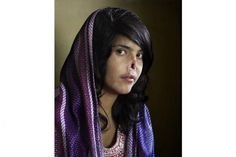 Photographer Jodi Bieber's portrait of Afghan Bibi Aisha, taken for Time magazine, was named the World Press Photo of the Year for
