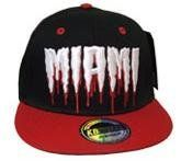 "Miami Monster Drip Cap Snap Back Hat (Black / Red ) by KB. $15.77. Quality Embroidery. 100% cotton. Celebrate your favorite team or city in this new ""drip"" style snap back hat from KB Ethos!"