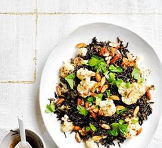 A cauliflower lover's delight, this hearty pilaf doubles-down on nutty flavours and textures with burnt butter, wild rice and toasted almonds. Perfect for barbecues, picnics and desk lunches. Gourmet Recipes, Whole Food Recipes, Vegan Recipes, Wild Rice Pilaf, Homemade Corn Tortillas, Vegan Ranch, Cauliflower Salad, Almond Recipes, Fall Recipes