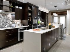 Love this kitchen!  The chandelier, the backsplash, the dark wood with white counter.