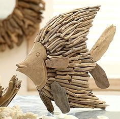 Driftwood Fish. Delightful Driftwood Decor Accessories: http://www.completely-coastal.com/2015/10/driftwood-decor-accessories.html