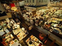 Fish vendor stalls at the Tsukiji market - it moves about five million pounds of seafood everyday