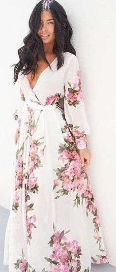 the floral print on this maxi dress is just stunning. She looks amazing in  it cd45b5dd88a