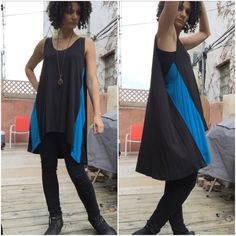 Kill City Hi/Lo Tunic Tank w Cobalt Panels Sz. Sm. This tunic tank is so super cool! The shock of cobalt gives it an interesting flair, and the stitching at the back gives it a cape-like draping. Worn a few times and in great shape overall. As always with rayon after the first wash, the blue panels have a teensy pillishness, but it's not noticeable on (see last pic). FYI I am wearing a black cami underneath. Kill City Tops Tunics