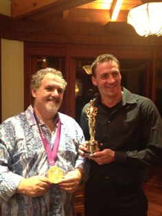 """""""I attend a Swim Across American charity event to benefit cancer research in Key Largo last month.  The event was held at the Jon Landau's home, the producer of Avatar and Titanic.  I had the honor of holding his Oscar for Titanic and he wore my Olympic Gold!  Jeah!"""" - Ryan Lochte"""
