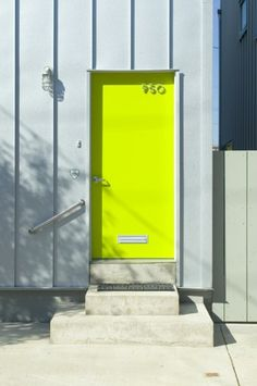 Neon door at a Philly townhouse, by Materiality Office // via Arch Daily