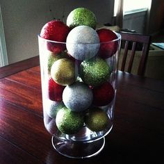 easy centerpiece for the holidays - ornaments in a hurricane vase! Simple Centerpieces, Holiday Centerpieces, Winter Christmas, Christmas Home, Holiday Ornaments, Christmas Decorations, Santa Breakfast, Hurricane Vase, Xmas Crafts
