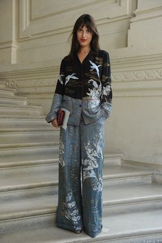 Jeanne Damas wearing a Valentino pajama from the Fall 2016 Collection to the Valentino Haute Couture Fall/Winter 2016 - 2017 Fashion Show on July 8th 2016.