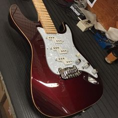 G&L Musical Instruments  Ruby Red Metallic over Empress, wood binding, pearl guard, number 1A profile maple neck with Clear Gloss finish.