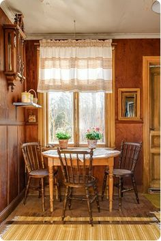 Table by the window; curtain; shelf over table