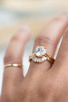 A fan of marquise, tapered baguettes and pear cut diamonds to arch around a center stone and enhance its sparkle. With modern and romantic vibes, she is the ultimate addition to any bridal stack. #considerthewldflwrs