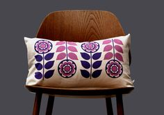 Scandinavian Retro flower 1970 purple pink  folk Cushion Cover by Gunna Ydri. $26.00, via Etsy.