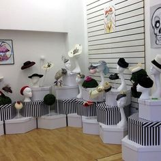 millinery pop up shop in London. Just love how the hat boxes have been stacked up and used as a display.