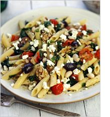 mediterrasian.com Greek-style pasta with white beans, feta, walnuts, spinach, cherry tomatoes and olives. Super healthy and delicious.