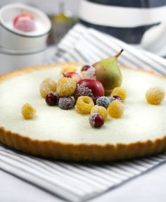 ricotta tart with sugared fruits.  Sounds like good recipe for tart crust (a little like shortbread and ricotta filling, though I will use whole eggs, I'm weird...) What a great base for all the lovely fresh strawberries that will soon be in season.  Yummy!  I love strawberry cheese pie, this will be a fancy version!