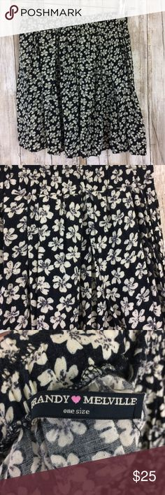 Brandy Melville Mini Skirt Flowers Black White OS Adorable Brandy Melville mini skirt. Black with white flowers floral. Elastic waist. One size. There is a small tear in the waist---see close up pictures. Boho, festival, hippie. Brandy Melville Skirts Mini