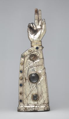 Arm Reliquary, 13th century, with 15th-century additions  French - Silver, silver-gilt, glass and rock-crystal cabochons over wood core    http://www.metmuseum.org/toah/works-of-art/17.190.353