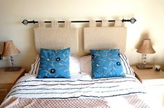 Spanish inspired headboard for bedroom. A great solution which is practical and stylish and you can choose from some lovely curtain poles and finials and quality fabric.