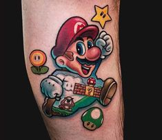 Perfect colors tattoo work of Super Mario Bros motive done by tattoo artist Marc Durrant Nintendo Tattoo, Gaming Tattoo, Super Mario Tattoo, Mario Kart, Mario Bros., Gamer Tattoos, Tatoos, Cartoon Tattoos, Tattoo Designs