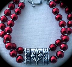 Rare Bali sterling double strand focal bead w/shocking red glass pearls.
