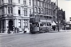 Camden High Street, corner of Greenland Road 1938 The number 5 tram, seen passing the station in an earlier picture in this set, passes the bank building on the corner of Camden High Street and Greenland Road on its way to Moorgate Camden London, Camden Town, Old London, North London, Old Pictures, Old Photos, Banks Building, Piccadilly Circus, World Geography