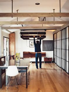 ceiling-suspended-bed with light under it.  Very cool space saving solution without having to climb a ladder.