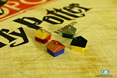 DIY Harry Potter Monopoly. Painting the monopoly houses the color of the Hogwarts houses.