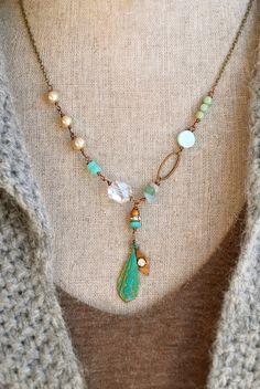 Mia...  was full of creativity   feaures glass beads,cystal ,vintage faux glass pearls,peruvian opal,amazonite gemstones,rhinestone bead,verdigris