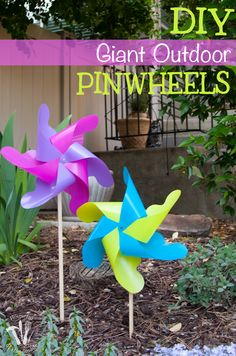 How fun are these pinwheels? These DIY Giant Outdoor pinwheels are made from plastic so they can withstand the weather. Perfect outdoor decor for your flower garden. | Housefulofhandmade.com