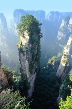 The amazing Wulingyuan Scenic Area is the site of over strange, narrow sandstone pillars that jut up into the sky over 200 meters high. Tianzi Mountains, Places To Travel, Places To See, Beautiful World, Beautiful Places, Strange Places, Bucket List Destinations, Adventure Is Out There, Dream Vacations