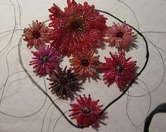 Step by step how to make a flower with a roveli center ~ Seed Bead Tutorials