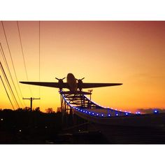 kim -  Sunset at The Roasterie coffee.  #KansasCity #coffee #airplanes