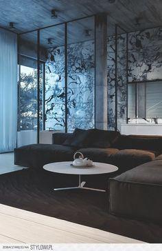 Tectos altos com parede estampada que se destaca neste apartamento de tons cinzas