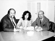 Jimmy Page signs Led Zeppelin's first recording contract in the presence of manager Peter Grant and Atlantic Records's Ahmet Ertegun. November, 1968.