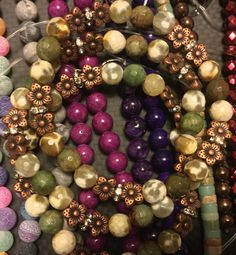 """Faceted Ruby zoisite, Yellow fire agate, copper """"plumeria"""" flowers, & shiny stuff to make it, well... Shine ;)."""