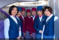 China Southern Airlines cabin crew members welcome guests aboard the operator's no. 1 October Ohoto by Airbus China Southern Airlines, Airline Cabin Crew, Airline Uniforms, Air China, Airport Lounge, Flight Attendant Life, Intelligent Women, Airline Flights, Photo Sessions