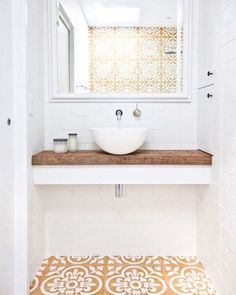 Using this bathroom every morning would be uplifting! Such a fun bright space! #interiordesign #bathroom #woodcountertop #pattern #tiles #subwaytile #bright #vesselsink #floatingvanity